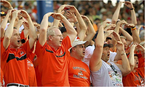 Who says the College World Series is just for students? These Beaver fans show the crowd which team they think will win.
