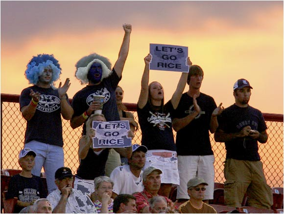 As the sun sets over Omaha, Rice fans cheer on their Owls.