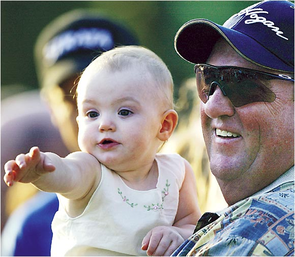 "Mike Furyk holds his granddaughter, Caleigh, as they celebrate Jim Furyk's Father's Day win at the 2003 U.S. Open. ""This,"" Jim told SI after winning the tournament, ""is a pretty perfect Father's Day."""