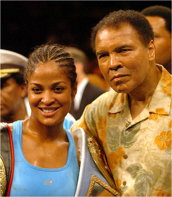 "A victorious Laila Ali poses with her father, the legendary Muhammad Ali, after she defeated Erin Toughill in Washington, D.C. When asked in a June 2002 SI interview what it would have been like to fight her father in his prime, Laila responded: ""I would get my ass beat."""