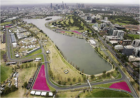 The Melbourne skyline dots the horizon behind the Australian Grand Prix course. On April 12, Australia's Mark Webber thrilled the crowd by briefly taking the lead before engine trouble cruelly stopped him cold. Fernando Alonso won.