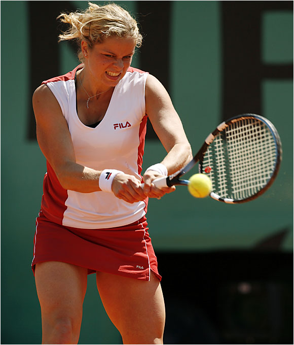 Two-time French Open runner-up Kim Clijsters defeated Martina Hingis in the quarters, setting up a semifinal matchup against fellow Belgian Justine Henin-Hardenne.