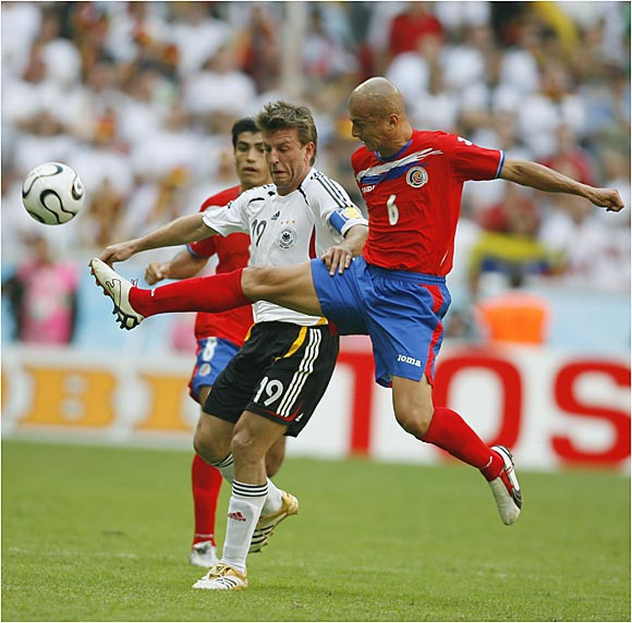 Danny Fonseca (right) and Costa Rica couldn't slip past Bernd Schneider and the heavily favored German team.