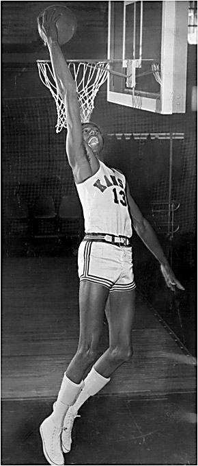 At Kansas, Chamberlain earned All-America honors in hoops twice in two years and led the Jayhawks to the 1957 national title game (a triple-OT loss to UNC). The Stilt was also a track star who won the high jump at the Big Eight championships.