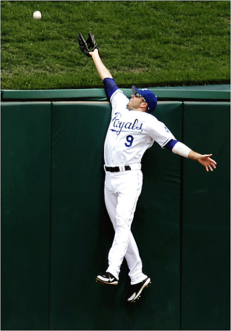 Royals center fielder David DeJesus watches one of six Devil Rays homers soar out of Kauffman Stadium. Carl Crawford and Jonny Gomes hit two home runs each. The lone bright spot for the Royals was a second-inning triple play.