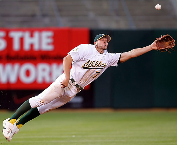 Oakland shortstop Bobby Crosby couldn't catch up with this line drive single by Minnesota's Rondell White. Unfortunately for the Twins, it was one of only five hits Barry Zito and the A's surrendered in Thursday's 4-0 win.