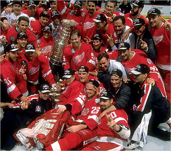 Gritty, experienced, and confident, Scotty Bowman's Wings soared to their second straight Cup sweep as goaltender Chris Osgood outplayed the Capitals' celebrated Olaf Kolzig. Wings captain Steve Yzerman won the Conn Smythe by leading all playoff scorers with 24 points. His two goals in Game 2, the second short-handed in the third period, rallied Detroit to a 5-4, Finals-turning win.