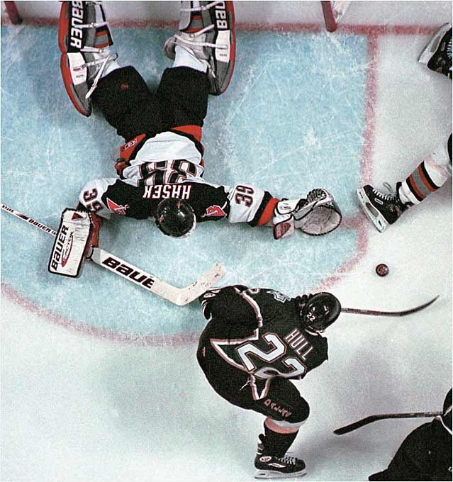 Brett Hull's disputed, foot-in-the-crease goal at 14:51 of triple OT in Game 6 is still a source of agony in Buffalo. The series was painful enough, marked at it was by nasty stickwork. Joe Nieuwendyk's six game-winning goals in the playoffs earned him the Conn Smythe as coach Ken Hitchcock's Stars won the first Cup in franchise history and became the NHL's first southern-based champion.