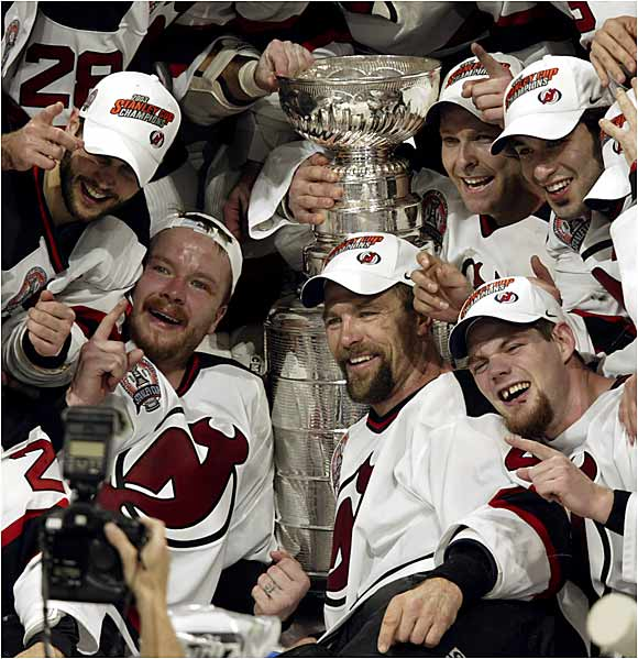 The Finals were a goaltending duel that featured four shutouts -- three by Devils' net-minder Martin Brodeur. But the Conn Smythe went to his Mighty Ducks counterpart Jean-Sebastien Giguere, who became only the fifth playoff MVP from a losing team. The Cup was Jersey's third in nine years -- each won by a different coach, this one by Pat Burns.