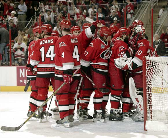 The Hurricanes capped their furious comeback from a three-goal hole with a celebration at the final buzzer of their 5-4 win in Game 1.