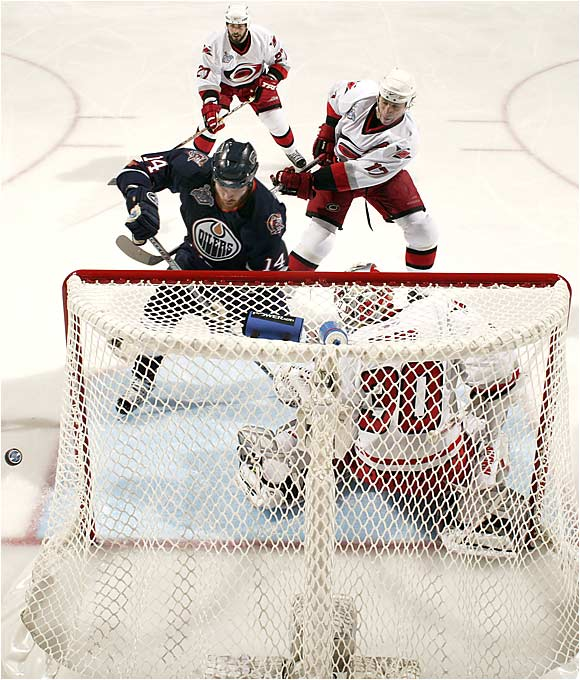 Carolina netminder Cam Ward returned to his hometown, where he was cheered on by his parents, and played cool and steady, making 28 saves. It took a disputed goal by Ryan Smyth with 2:15 left in the third period to beat him.