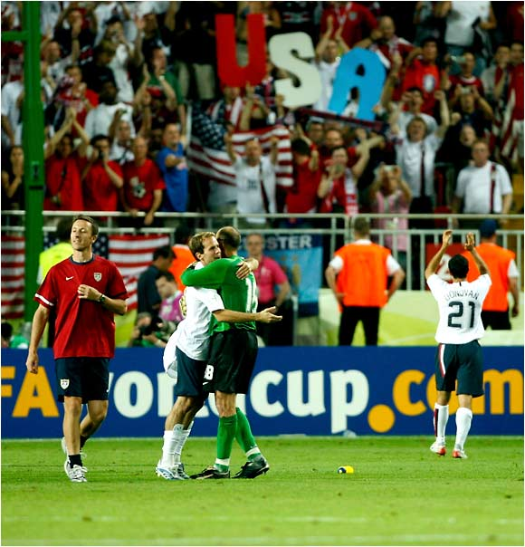 The U.S. team and its fans celebrate after earning a much-needed point by battling Italy to a 1-1 draw.