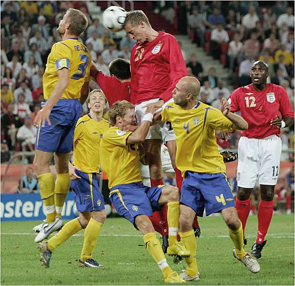 Peter Crouch extends for a header during England's match against Sweden in Cologne. England will face Ecuador on Sunday in Stuttgart during the elimination round.