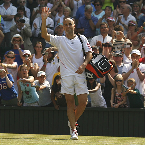 Andre Agassi bids one last farewell to the crowd at Wimbledon after losing to Rafael Nadal.