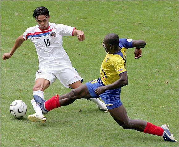 Segundo Castillo makes a hard sliding tackle on Costa Rica's Walter Centeno during Thursday's match in Hamburg.