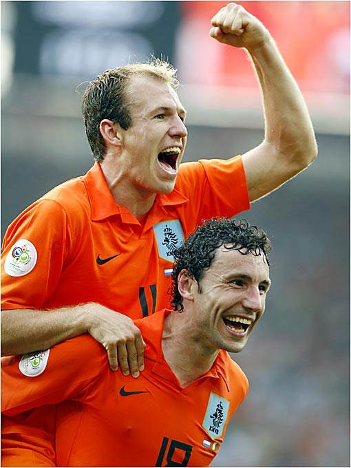 Arjen Robben and Mark Van Bommel celebrate an exhilarating 2-1 victory over the Ivory Coast. The Netherlands advanced to the round of 16, while the Ivory Coast, which fought valiantly in two matches, was eliminated from the tournament.