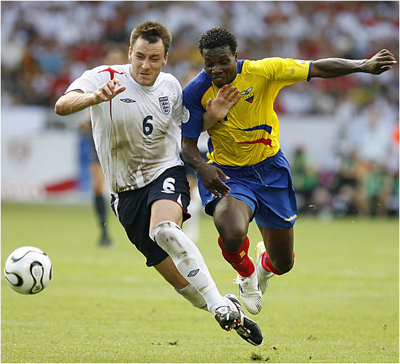 England's John Terry outraces Ecuador's Carlos Tenorio to the ball.