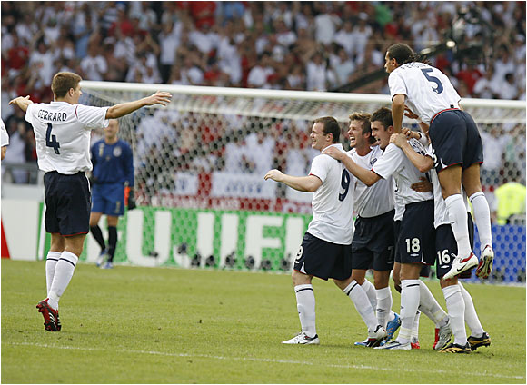 England players celebrate David Beckham's goal during their 1-0 victory over Ecuador on Saturday. The goal was Beckham's first in nearly 15 months and his 17th in 93 international appearances.