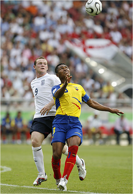 Ecuador's Ivan Hurtado fights with England's Wayne Rooney for control of the ball. The English team, looking for its first World Cup title since 1966, faces Portugal on Saturday.