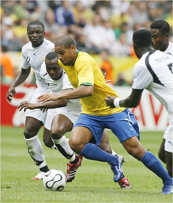 Brazil striker Adriano weaves through four Ghana defenders during the first half of Tuesday's victory.