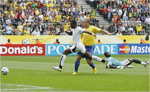 Ghana's John Pantsil appears to have this loose ball under control, but Ronaldo was able to break free for the game's first goal. Brazil scored two more goals to defeat Ghana 3-0.