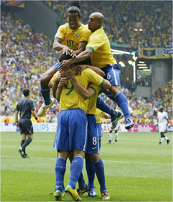 Ronaldo and the rest of his Brazilian teammates celebrate the first goal of the game, and his World Cup-record 15th goal, which broke Gerd Mueller's all-time tournament scoring record.