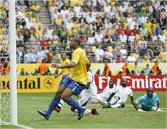 Adriano scores Brazil's second goal of the game as helpless members of Ghana's team look on. Replays appeared to show that Adriano was offside when he kicked the ball in the net, but the goal held up.