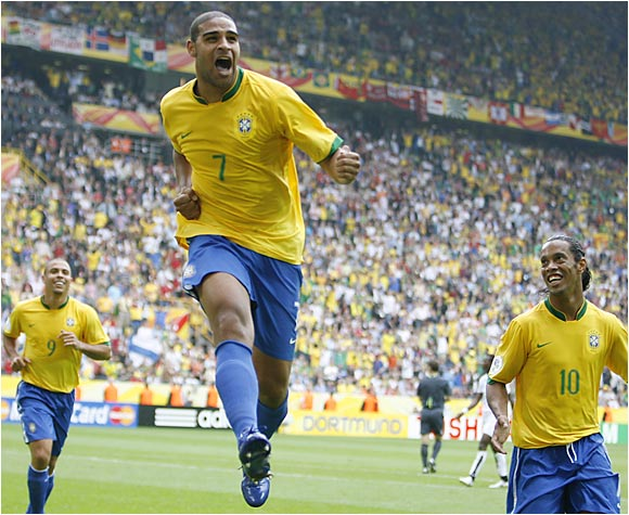 Adriano celebrates his goal with teammates Ronaldo and Ronaldinho. The goal gave Brazil a two-goal cushion, from which Ghana was unable to recover.