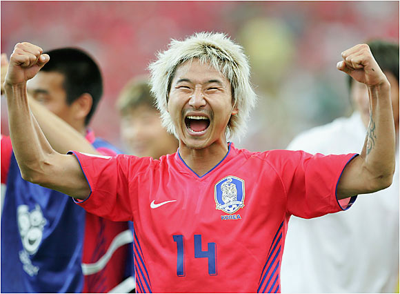 Chun-Soo Lee celebrates following South Korea's 2-1 win over Togo.