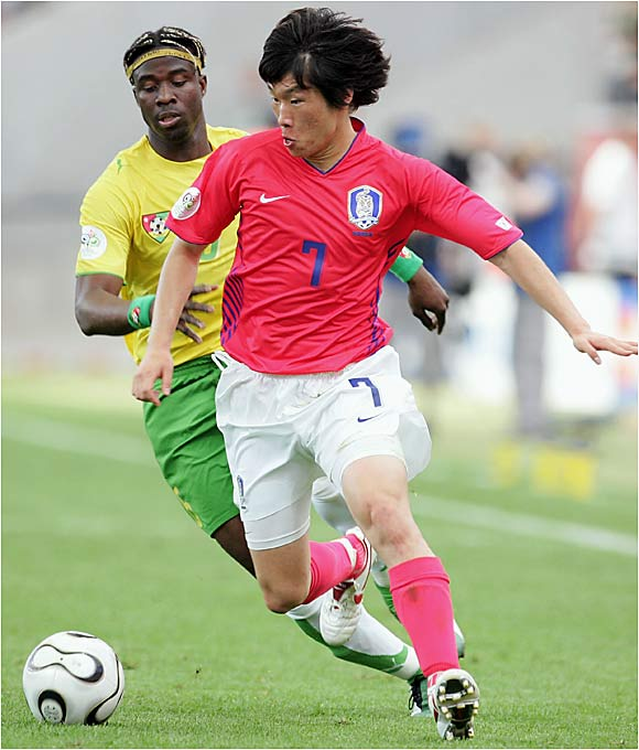Ji-Sung Park (right) and South Korea narrowly escaped their opening match against Togo, the lowest-ranked team in the tournament. Togo might have pulled off the upset had it not lost its captain, Jean-Paul Abalo, to a red card in the 53rd minute.