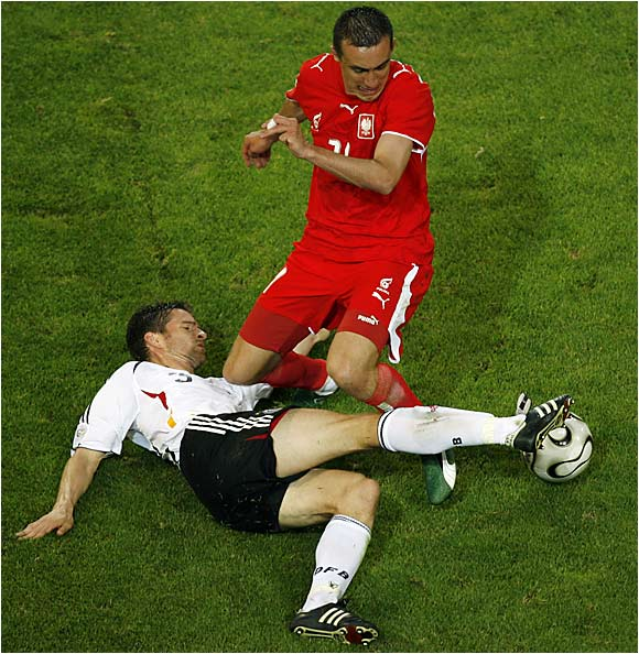 Germany's Friedrich Arne tries to steal the ball from Poland's Jelen Ireneusz with this sliding tackle during Wednesday's game in Dortmund.