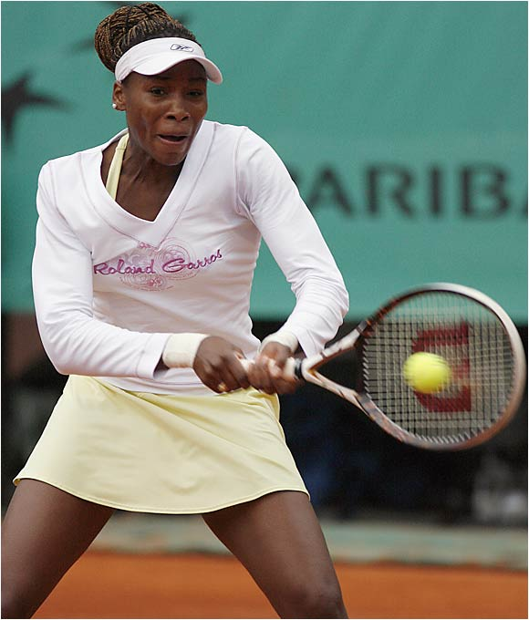 Because of the frigid weather, Venus Williams had her trainer buy a top with ''Roland Garros'' written across the front, because she hadn't brought any long-sleeved shirts that would be allowed on court.