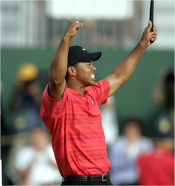Tiger Woods finished at 18-under 270, missing an 8-foot birdie putt that would have matched his record (19 under) set at St. Andrews six years ago.