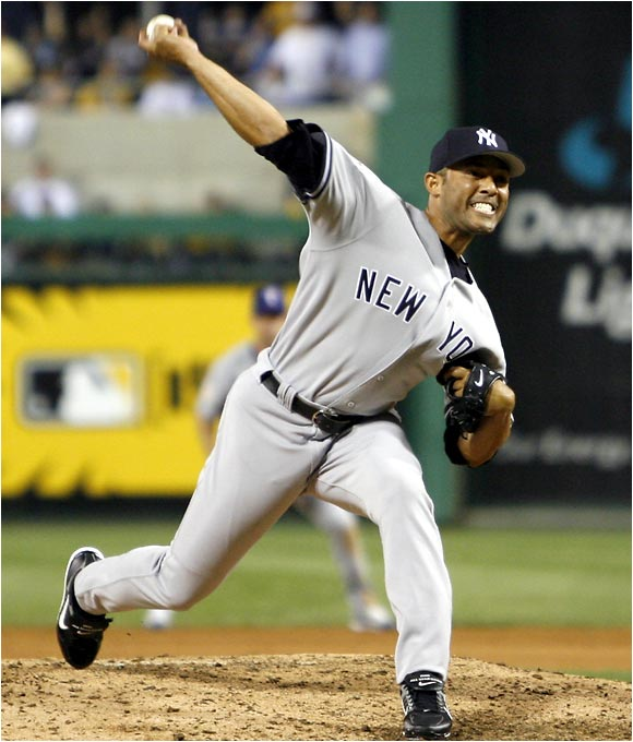 Mariano Rivera retired the side in the ninth inning for his record-tying third career All-Star Game save.