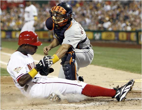 Ivan Rodriguez prevents Alfonso Soriano from scoring a run in the third inning.