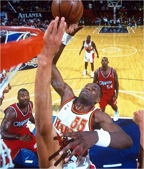 It may not have had the cachet of Shaquille O'Neal's jump to Los Angeles, but Mutombo set the Denver Nuggets back quite a bit after signing with the Atlanta Hawks. Denver tried one year of run-and-gun before falling apart entirely in the hands of GM-coach Dan Issel over the next half-decade. Mutombo missed only seven games in 41/2 seasons with the Hawks, winning two Defensive Player of the Year awards and making the All-Star team four times while manning the pivot for a team that made the conference semifinals twice.
