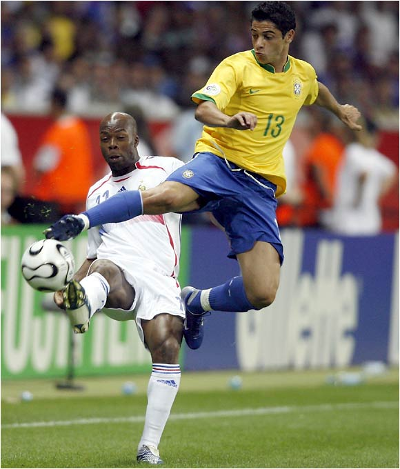 Juninho gets major hang time in battling for a ball with France's Sylvain Wiltord.