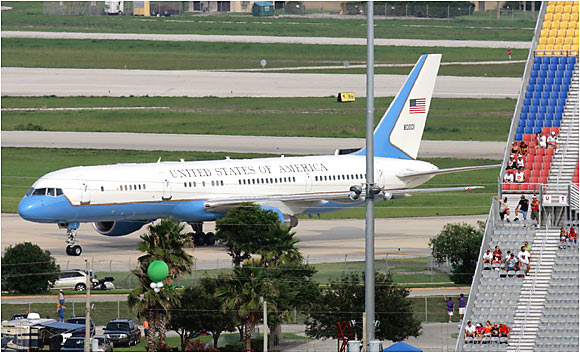 Air Force Two, carrying Vice President Dick Cheney and a contingent from Sports Illustrated, touches down at Daytona International Airport as fans begin to file in at the adjacent racetrack.