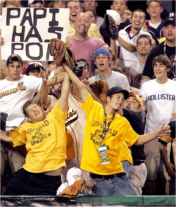 A couple of Pittsburgh fans battle for one of the many homers hit during the derby.
