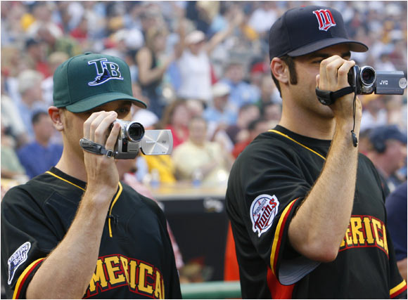 First-time All-Stars Scott Kazmir and Joe Mauer marvel at the Home Run Derby.