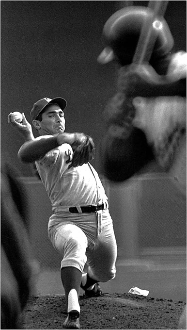 Blessed with a blazing fastball as well, Koufax threw his curve overhand, which is rare for a left-handed pitcher. The curve would break straight down, forcing hitters to beat it into the ground.