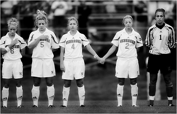 University of Nebraska players leaving a space for Coop during the national anthem September 9, 2004.