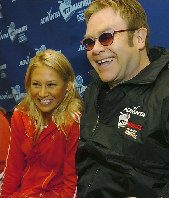 Kournikova joins Elton John at an annual tennis event to help the singer's AIDS foundation.