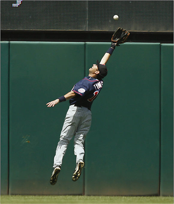 Twins outfielder Jason Tyner makes a leaping catch on Sunday against the Indians in Cleveland. Everything has been clicking for the Twins, who have posted a 31-8 record since the first week of June.