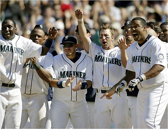 The Mariners wait at home plate for teammate Richie Sexson, who hit a game-winning home run off Mike Timlin that gave Seattle a 9-8 victory over the Red Sox at Safeco Field on Sunday.
