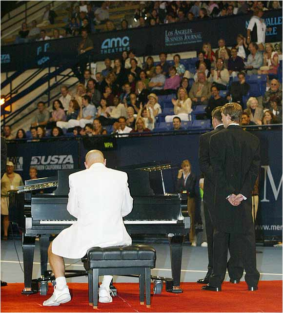 "At the ""Night at the Net"" benefit, held before the Mercedes-Benz Cup in Los Angeles, Andre Agassi excites the crowd by showing off his piano skills."