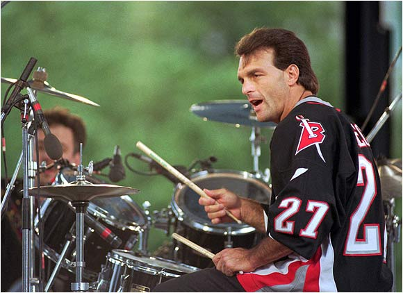 Doug Flutie is many things: a quarterback, a drop-kick field goal artist and -- as you can tell -- a drummer. Here he plays with the Flutie Brothers Band in Buffalo.