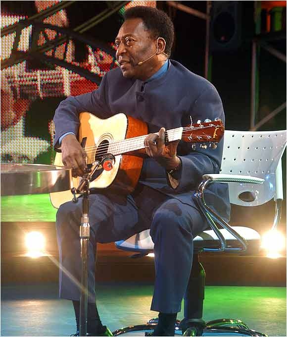 "Pelé opens the premiere of Maradona's television show, ""La Noche del 10,"" in Buenos Aires. The soccer god both sang and played the guitar."