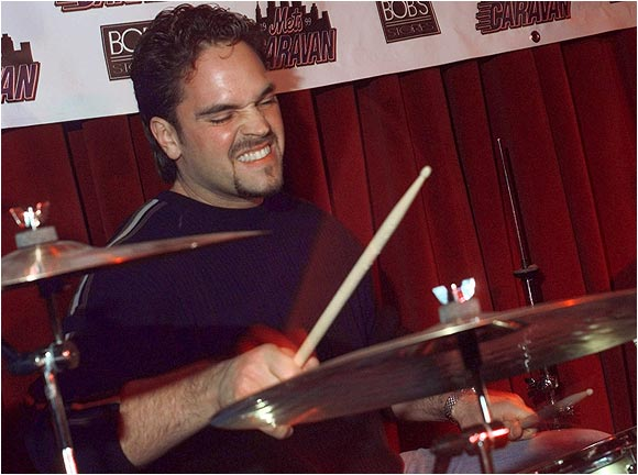 "Mike Piazza cuts loose on the drums with the ""Bogmen"" in New York. He and his then Mets teammates were making an appearance for the Make-A-Wish Foundation."