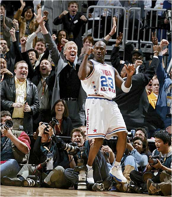 Former NBA star Bill Walton celebrates Michael Jordan's shot during the 2003 All-Star game.